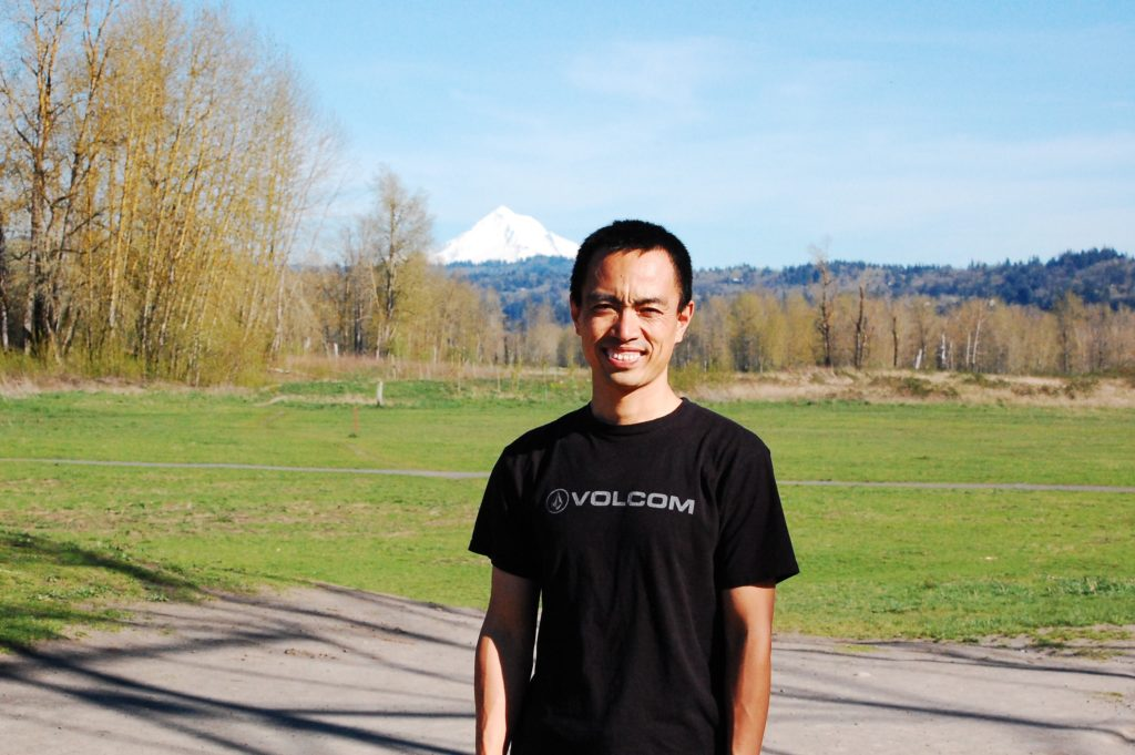 Tiebing Zhang, cofounder and CTO of Circle Media, stands with Oregon's Mount Hood in the background.